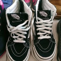 pair of black Vans Sk8-Hi sneakers 49 km