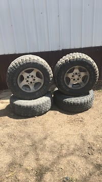 Jeep or ford escape rims 4 1/4 x 5 with 30x9.5x15 Des Moines, 50313