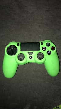 green and black Sony PS4 controller Bedford, B4A 4C5
