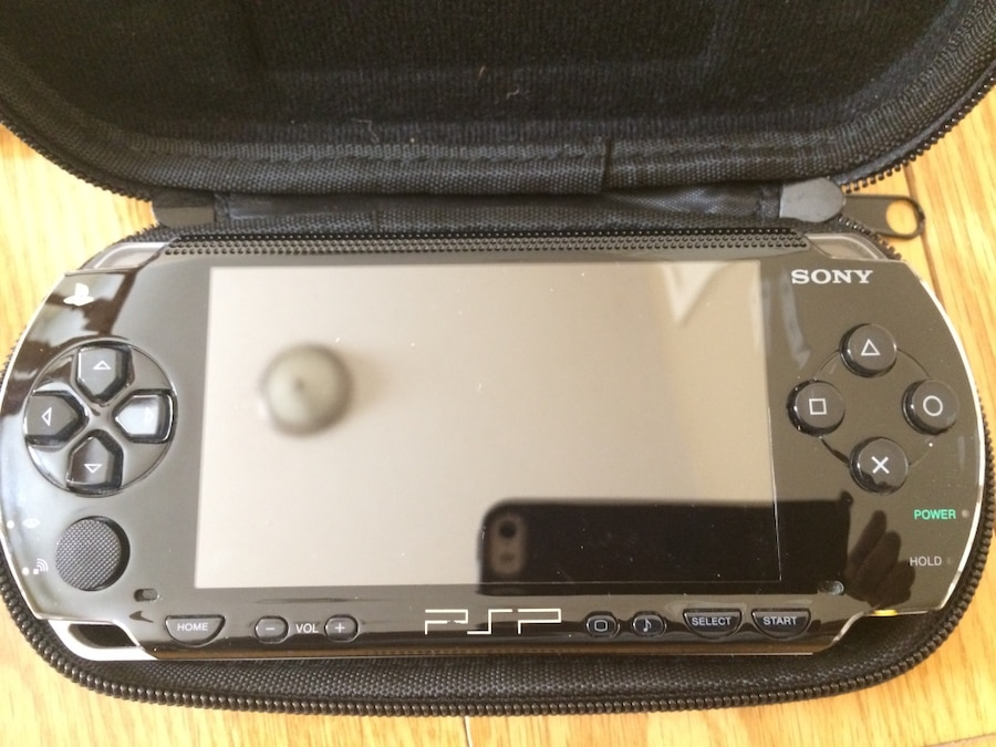 black Sony PSP with case for sale  Mississauga