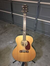 Brown dreadnought acoustic guitar with stand Houston, 77034