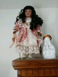 porcelain doll wearing white and pink dress Melbourne, 32935
