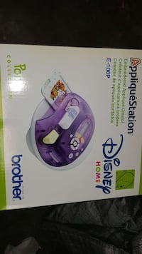 purple and white Disney Home photo printer box Washington, 20032