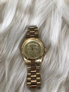 round Michael Kors chronograph watch with gold link bracelet