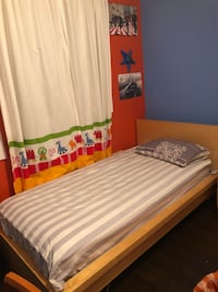 Twin bed with mattress and side table