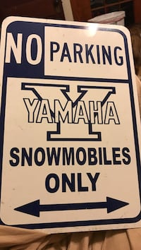 white and black No Parking Yamah snowmobiles only signage