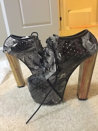 pair of women's black-and-silver platform leather chunky heel shoes