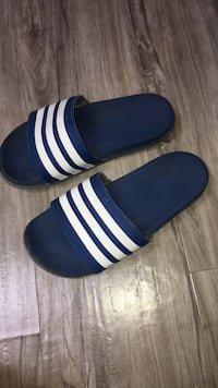 Pair of blue-and-white adidas slide sandals size 4 used lots of life left  London, N5W 1E8
