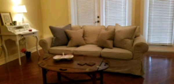Beige fabric sectional sofa with throw pillows