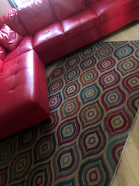 Red couch with rug  Newark