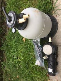 Above ground pool sand filter, new pump and filter head and hose.