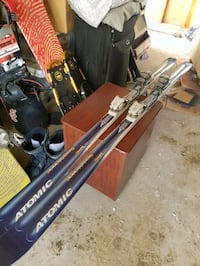 pair of blue-and-gray Atomic ski blades 3131 km