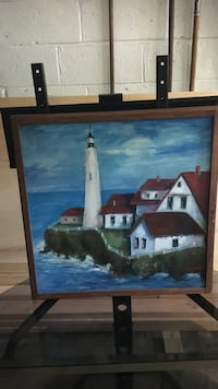 Houses and lighthouse painting