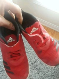 pair of red-and-black Adidas sneakers Mississauga, L5L 3M1