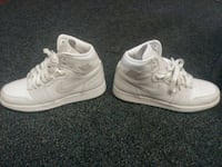 pair of white Nike Air Force 1 high shoes 2292 mi