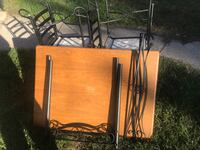 brown wooden table with chairs South Bend, 46614
