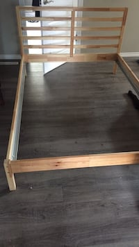 brown wooden bed frame with white mattress Sylvan Lake, T4S