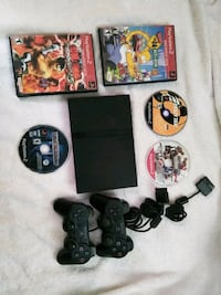 PS2 Slim w/ 2 controllers and 5 games  Los Angeles, 90011