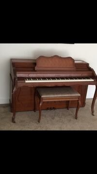 Brown and black upright piano Alexandria, 22312