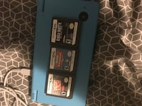 black Nintendo DS with game cartridges St Catharines, L2T 3A4