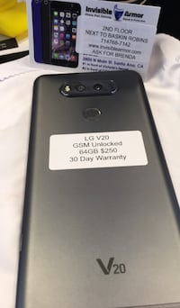 black LG android smartphone with box