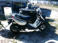white and black motor scooter Navarre, 32566