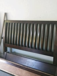 baby's brown wooden crib Vero Beach