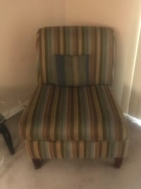 brown and white striped padded sofa chair