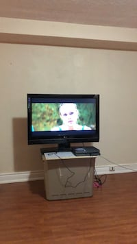 Black flat screen tv with wall mounts and stand Toronto, M1B 1Y1