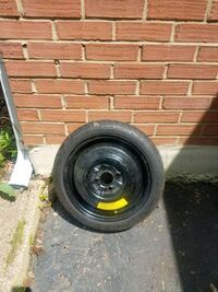 Ford branded 4 bolt car spare tire