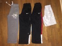 Four assorted color track pants