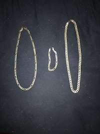 Two silver chain necklaces and one chain bracelet