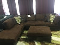 Microfiber Sectional with ottoman. Reverse option available. Brand new.  Irving