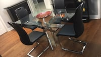 black and gray metal base glass top table