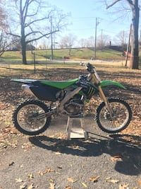 black and green motocross dirt bike 61 km