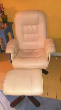 white leather padded rolling armchair Surrey, V3T 3X1