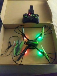black and green quadcopter with remote 67 mi