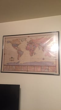 Beige, brown, and blue world map. Needs new frame