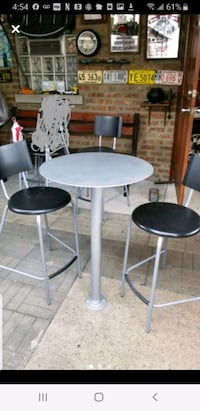 Metal bar table with 3 high chairs from IKEA