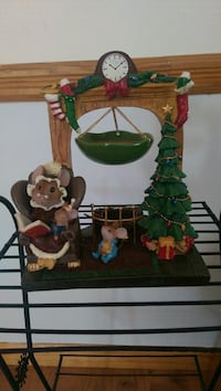 green Christmas tree near fireplace and cats figurine