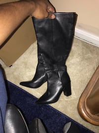 pair of black leather knee-high boots Columbia, 21045