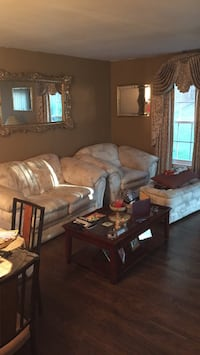 Cream white sofa and chair and ottoman. Good condition