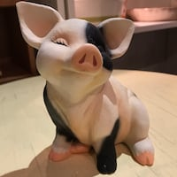 white and black pig figurine 601 km