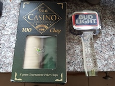 100 clay poker chips and bud light beer tap