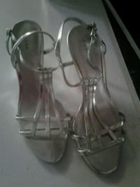 Silver high heel shoes size 8.5