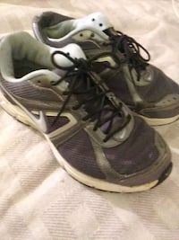 pair of gray-and-white Nike running shoes Stone Mountain, 30087