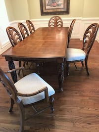 Solid wood 8 setting 2 leaf dining table. Conyers, 30094
