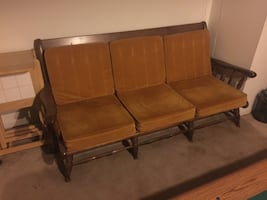 Brown wooden frame with brown padded bench