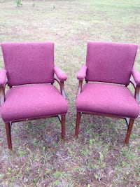 two brown wooden framed purple padded armchairs Merritt Island