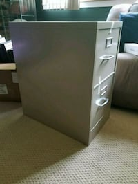 white and gray wooden 3-drawer chest